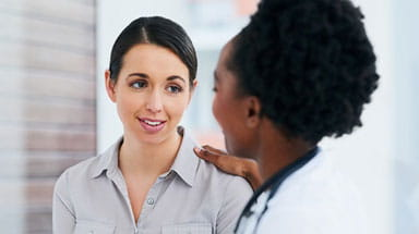 Doctor consulting breast cancer patient